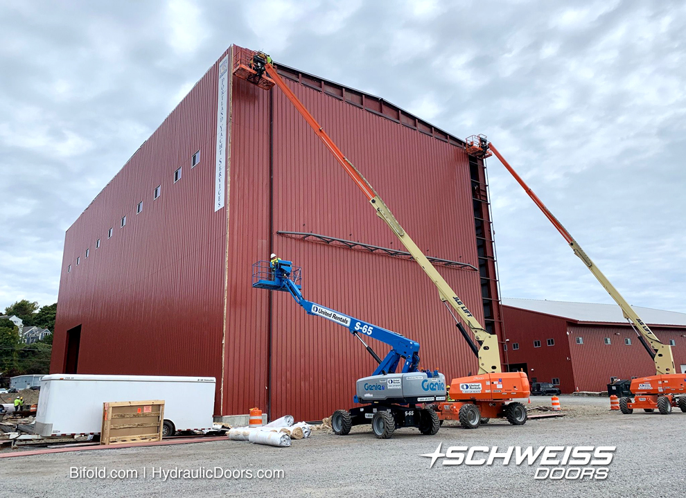 Irishspan Industries workers are installing the siding on Tall Schweiss Ship Door.