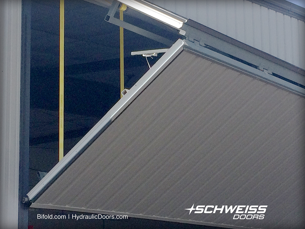 Seven strong liftstraps move the hangar door, and Schweiss door also is fitted with manual latching system