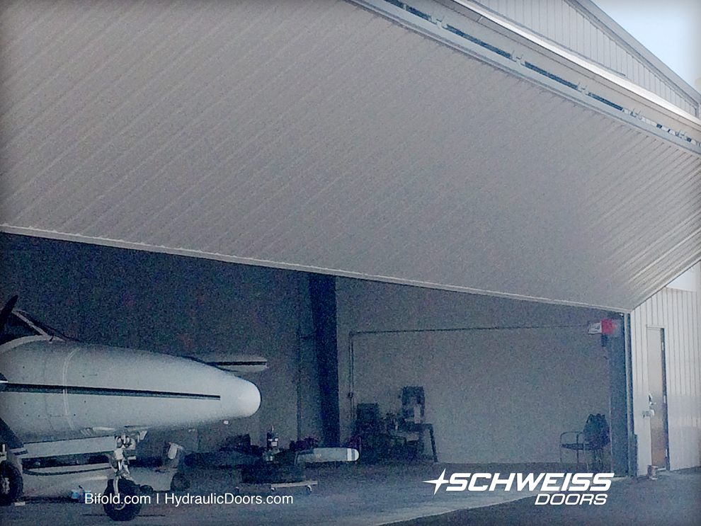 Bifold Door over Hydraulic Door choice for Propworks was because of being able to park closer to the hangar door.