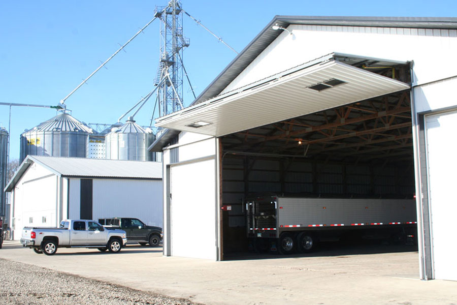 A semi-trailer parked in a machine shed