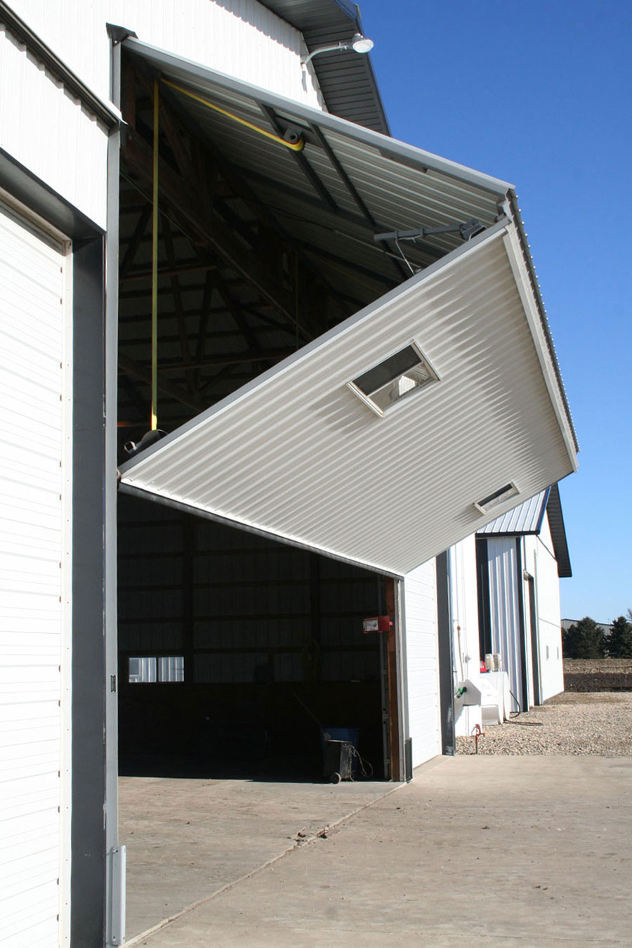 Bifold equipment shed door halfway open