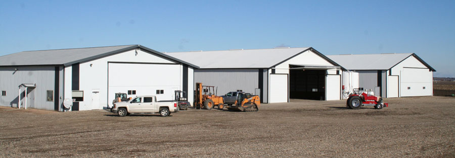 Three farm machinery sheds with Schweiss doors