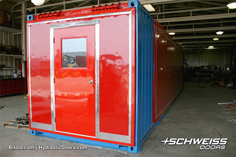 8 x 8 ft hydraulic door with a 7 x 3 ft walk door