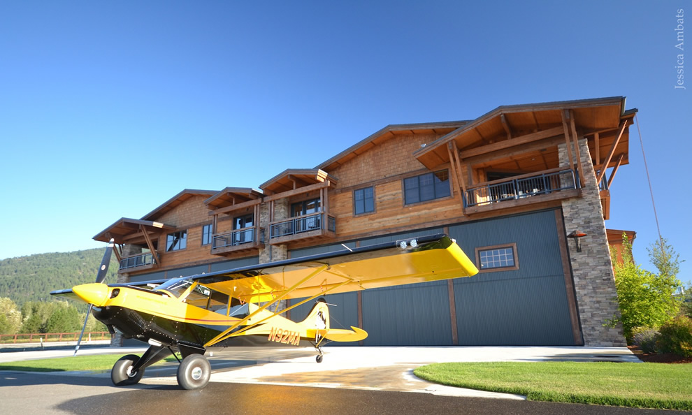 Husky Backcountry Plane Sits Outside One Of The Beautiful Hangar Homes