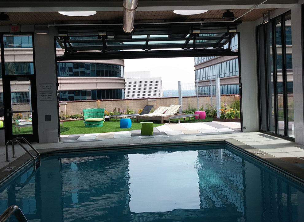 The Schweiss bifold designer door can be left partially open to provide ventilation to the inside of the pool room. & Soo Line Building City Apartments | Schweiss Must See Photos