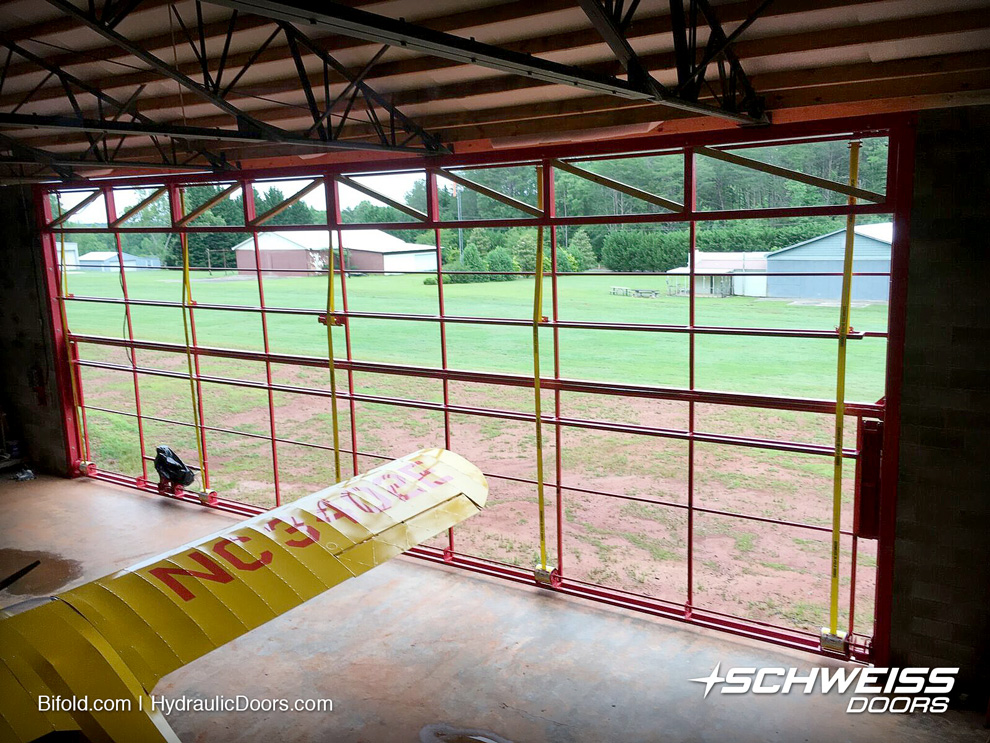 Wide bifold hangar door