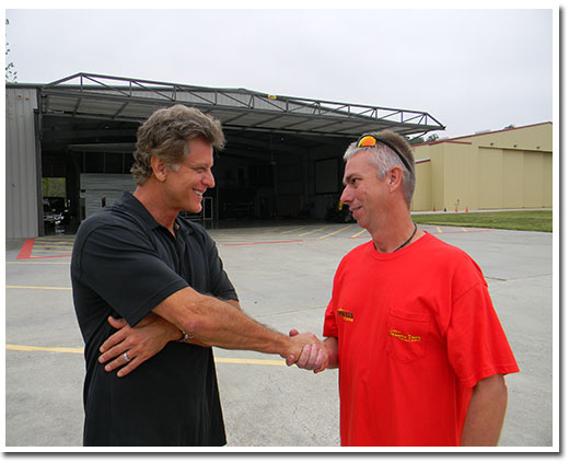 Patrick and Roy the installer of the hangar door shaking hands.