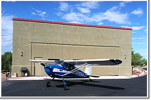 Aircraft in front of hydraulic stucco door