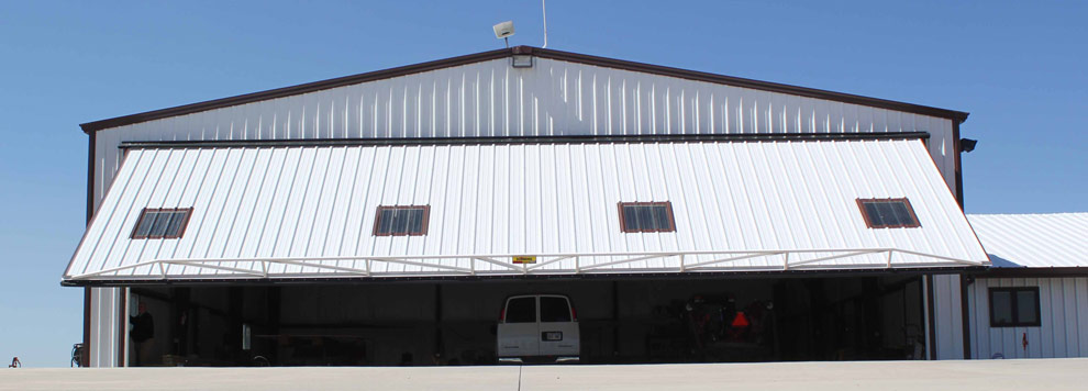 Windows in the big door provide natural light inside the hangar