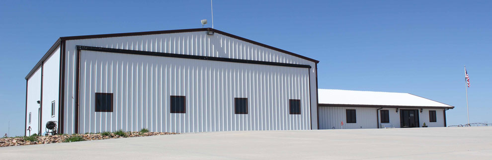 Hangar big enough for agriculture equipment and an airplane