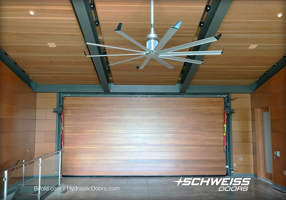 Interior of Schweiss Hydraulic Bifold door is clad with Vertical Douglas Fir.