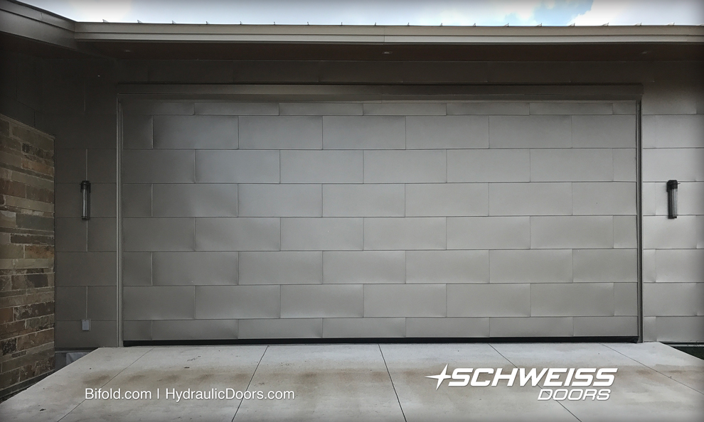 Hydraulic door exterior is clad in 24 gauge metal panels