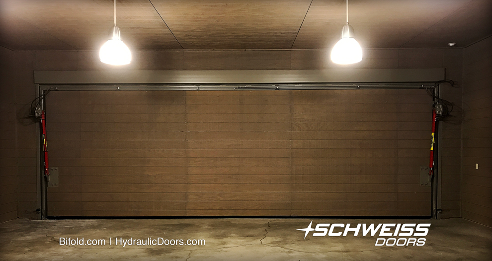 65' away from mechanical room is the hydraulic pump, and along with the two strong hydraulic cylinder, they lift the wide garage door