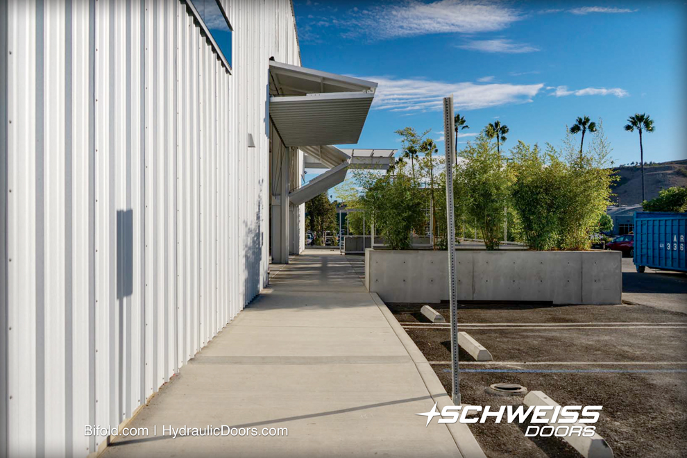 Photo eye sensors were added to the two 23' x 15' Schweiss Bifold Doors.