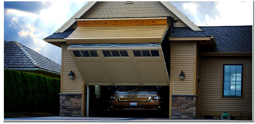 Two patented Schweiss liftstraps and a heavy-duty bottom-drive motor easily lift the 16 ft. RV Schweiss bifold garage door.