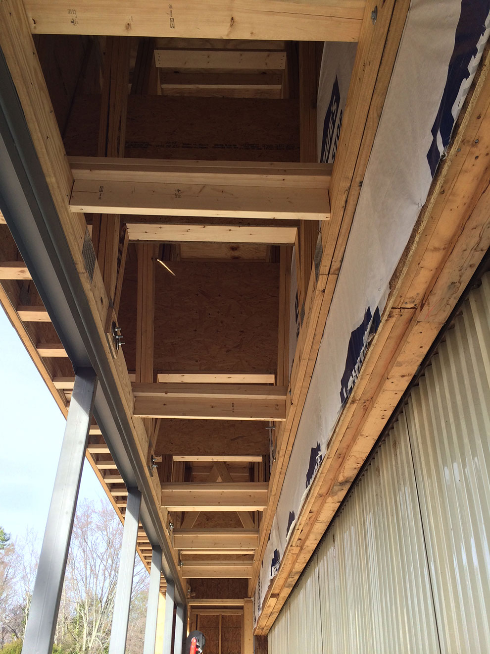 Reinforced framework on building to support large hydraulic door