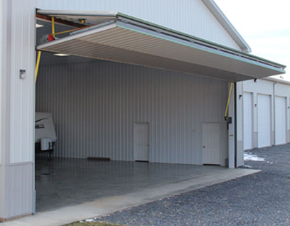 Schweiss Door opens shed for RV & Bifold Doors - Hangar Doors | Hydraulic Doors | Schweiss Doors