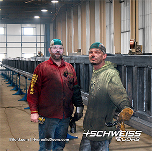 Schweiss Employees working on Large Liftstrap Doors