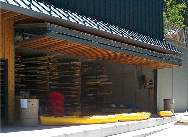 Lake Tahoe Boathouse Schweiss Door is clad with wood evenly spaced across door