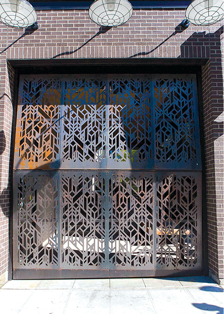 Schweiss Apartment Doors is clad in Decorative Metal Panel