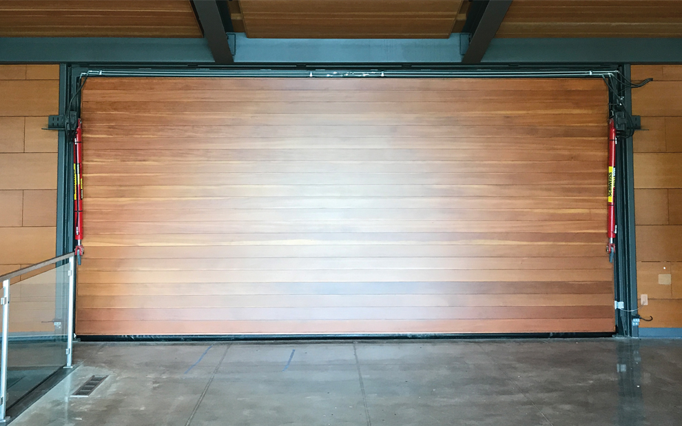 Schweiss Hydraulic Garage Door's Interior is lined with wood
