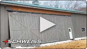 Schweiss One-Piece Door clad in custom wood siding.