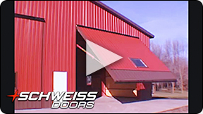 Red Power Hydraulics moving large Schweiss One-Piece Door