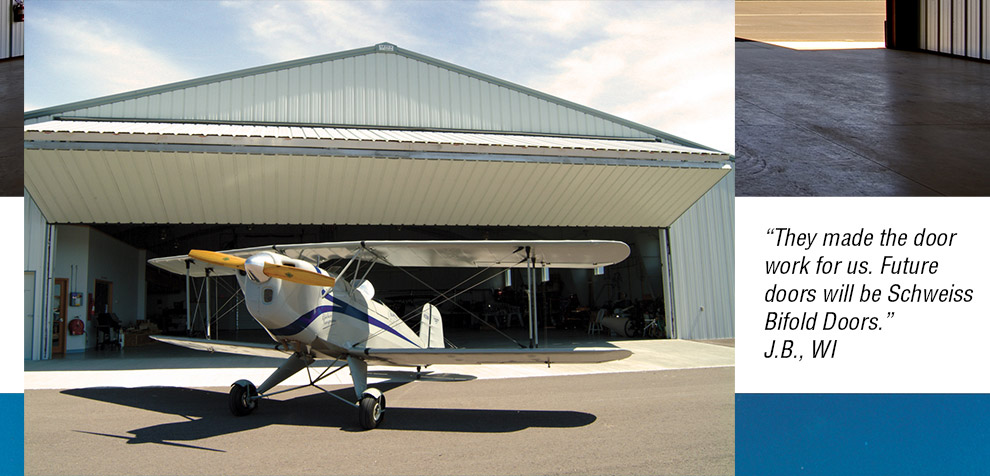 airplane infront of bifold hangar door