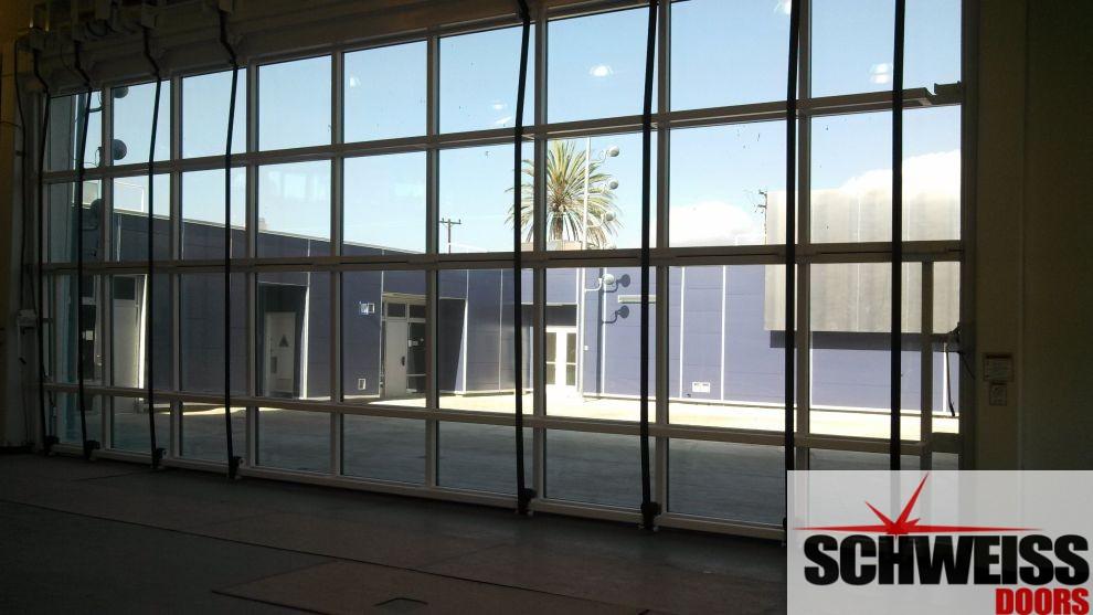 Bifold liftstrap designer glass school door
