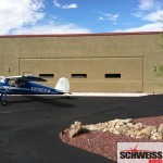 Arizona stucco clad aircraft hydraulic hangar door