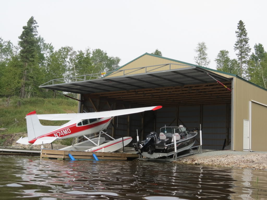 Schweiss specializes in hydraulic and bifold floatplane, seaplane, boathouse and marina doors.
