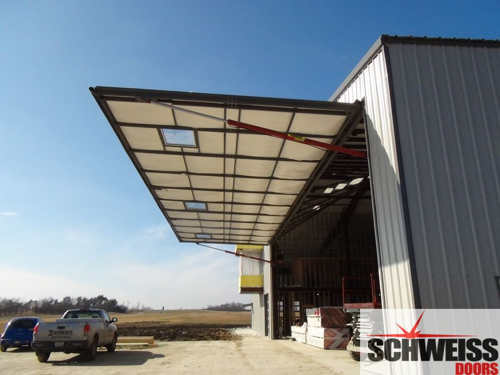 Hydraulic door canopy