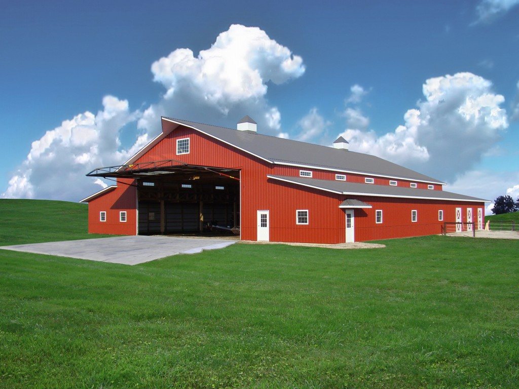"This ""Country Style"" red barn has a 40 ft. Schweiss hydraulic one piece door on it. It's owned by an Illinois crop sprayer and gives him easy access to bring his choppers into the work shop."