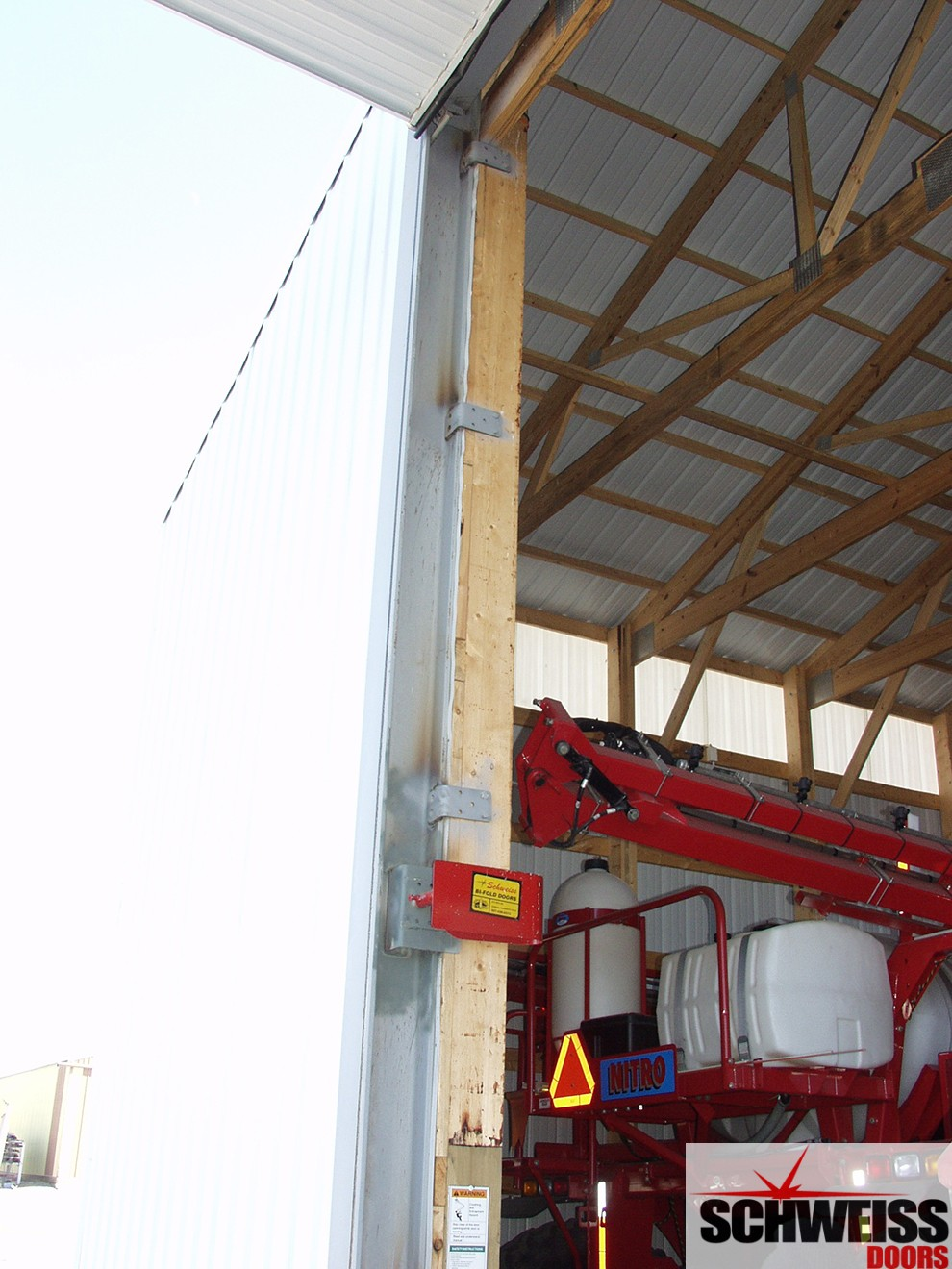 Hydraulic door sub-frame attaches to vertical jambs