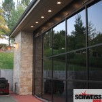 Hydraulic doors with glass for patios and garages
