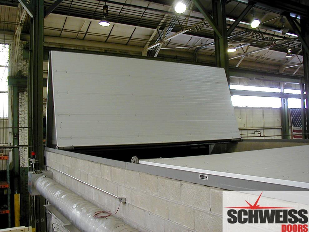 """Bifold doors become industrial sandblast chamber """"roof doors"""""""