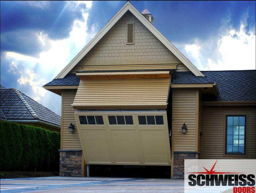Bifold door for RV motorhome garage meets local zoning ordinance restrictions