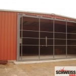 Schweiss Hydraulic doors for agriculture, marina and storage sheds