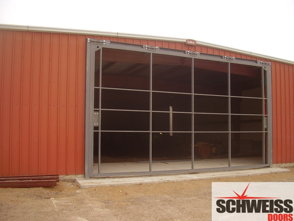 Hydraulic doors for ag, marina and storage sheds