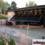 Hydraulic patio and garage doors with glass exterior