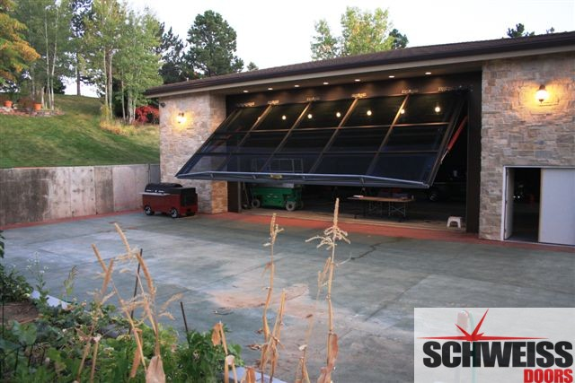 Hydraulic patio and garage doors with glass