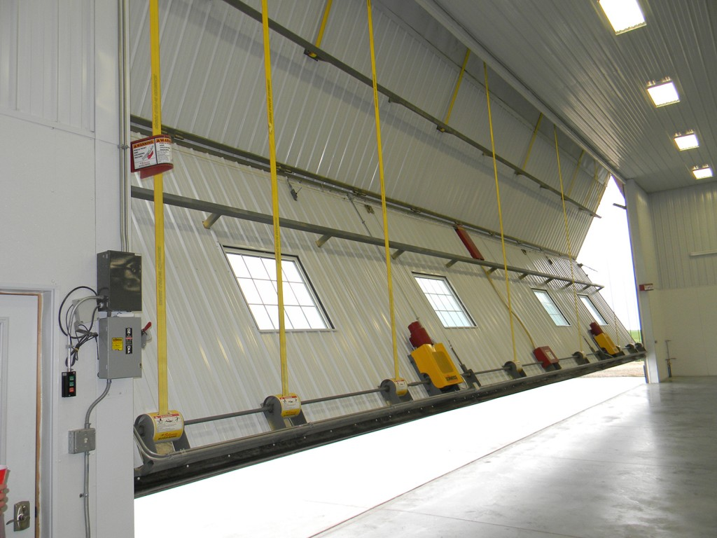 Patented bifold liftstraps and autolatches are available only from Schweiss Doors