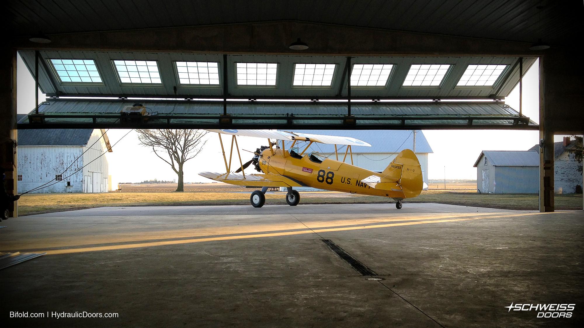 Schweiss Hangar Door opens to let Bi-Plane out of hangar